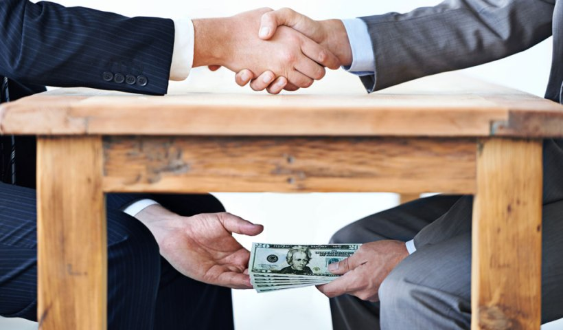 BLOG-1024x600-money-under-the-table-PeopleImages-iStock-477514725