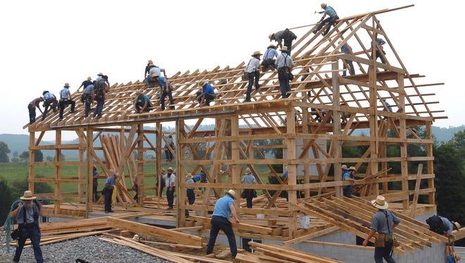1408119569000-AP-Barn-Raising (1)
